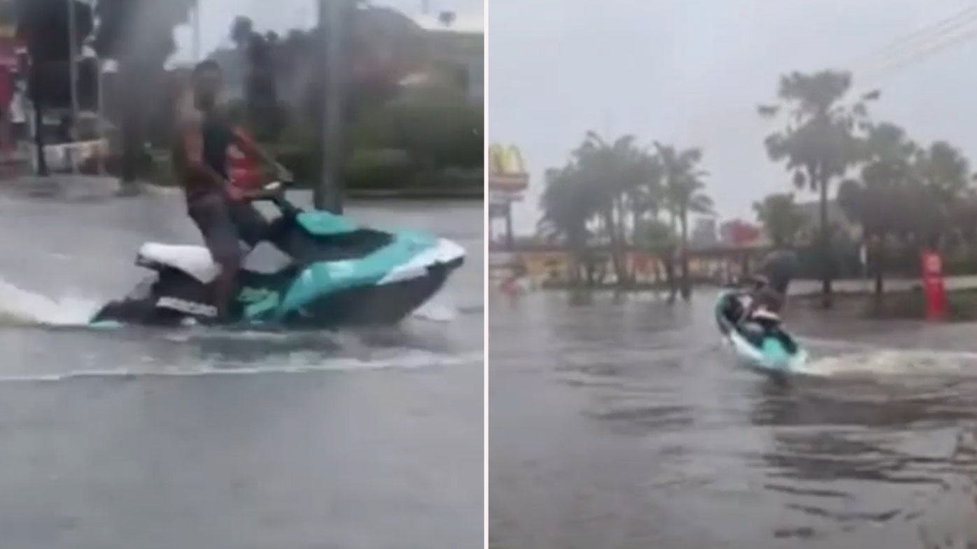 A man has been seen riding a jet ski through floodwaters in NSW.