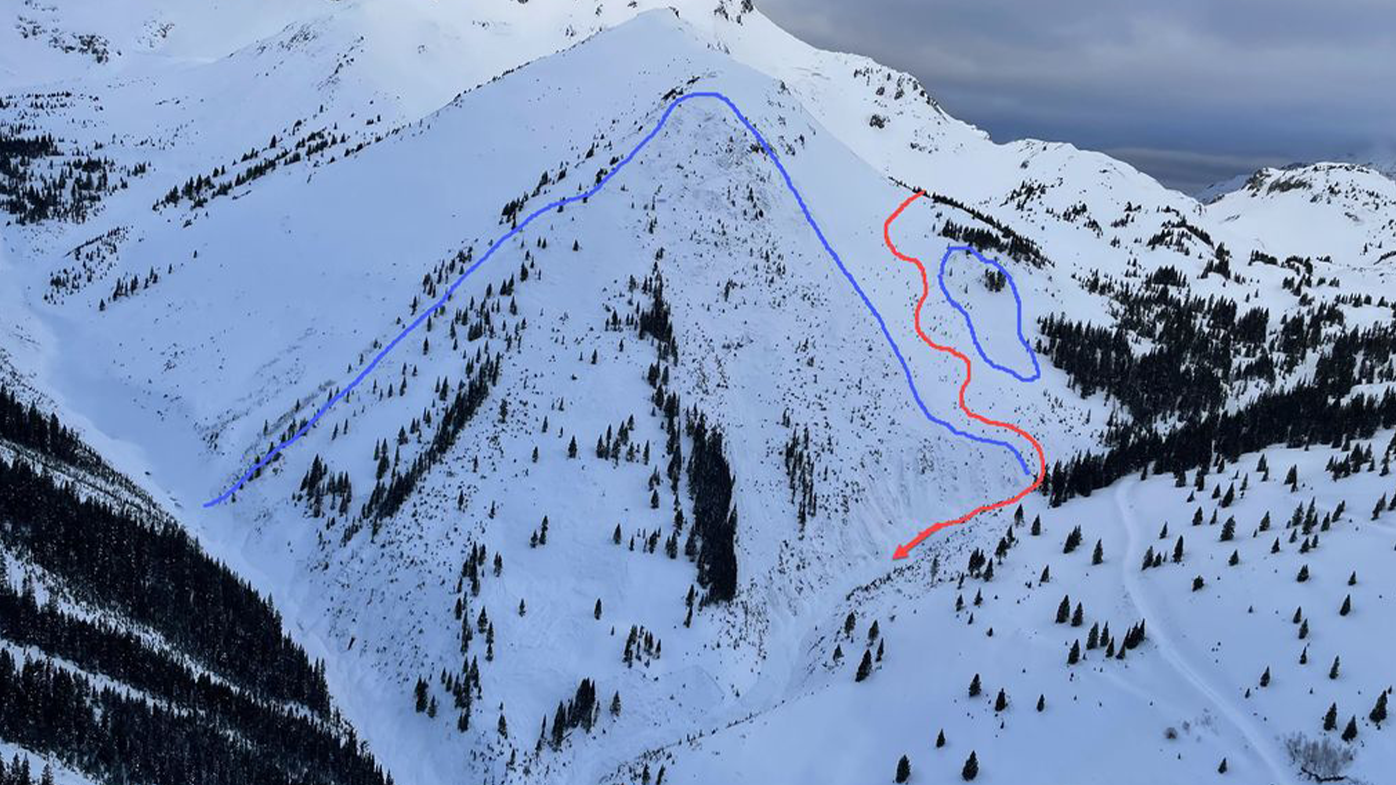 This image is an overview of the accident site. The red line marks the general path of the group, down the slope and then down the gully.