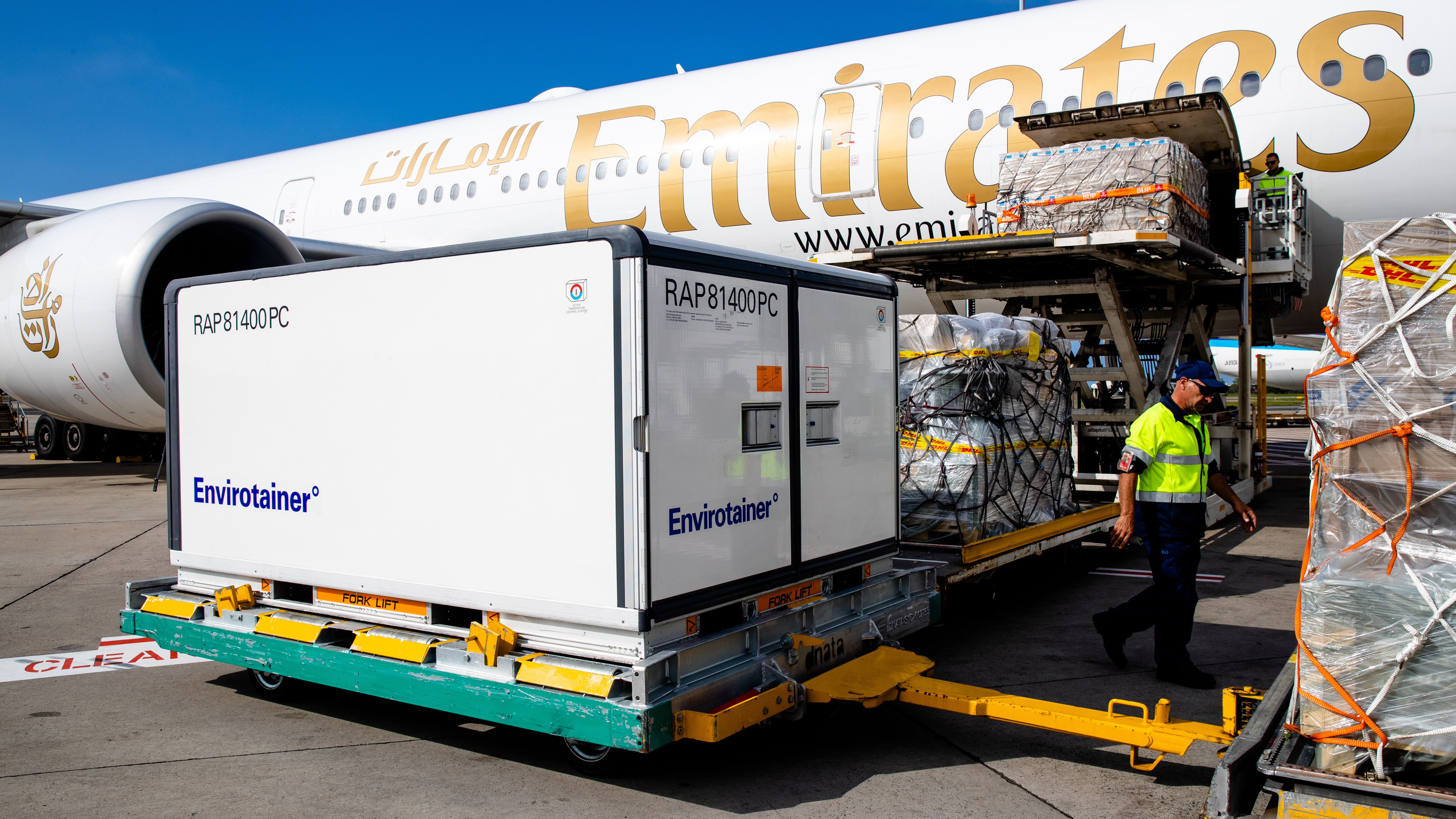 Container holding the AstraZeneca COVID-19 vaccine is removed from the Emirates airlines plane as the first vaccination doses into the country arrives at Sydney International airport.