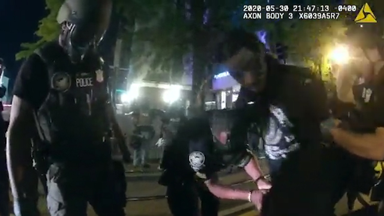 Officers were filmed in downtown Atlanta breaking the windows of the vehicle the two people were in, yanking a woman out of the car and tasing the man.