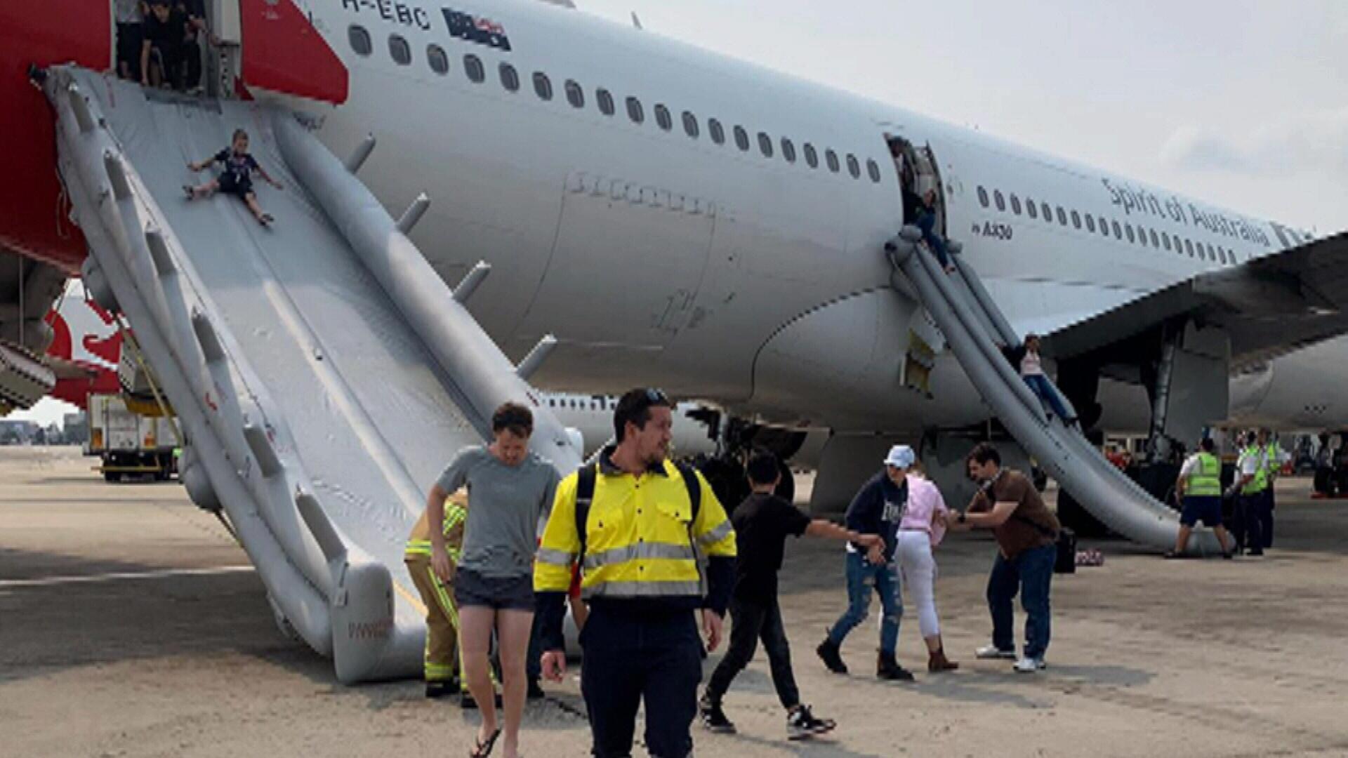 'Evacuate, evacuate, evacuate!': Passengers sent down slides as cabin fills with hydraulic fluid