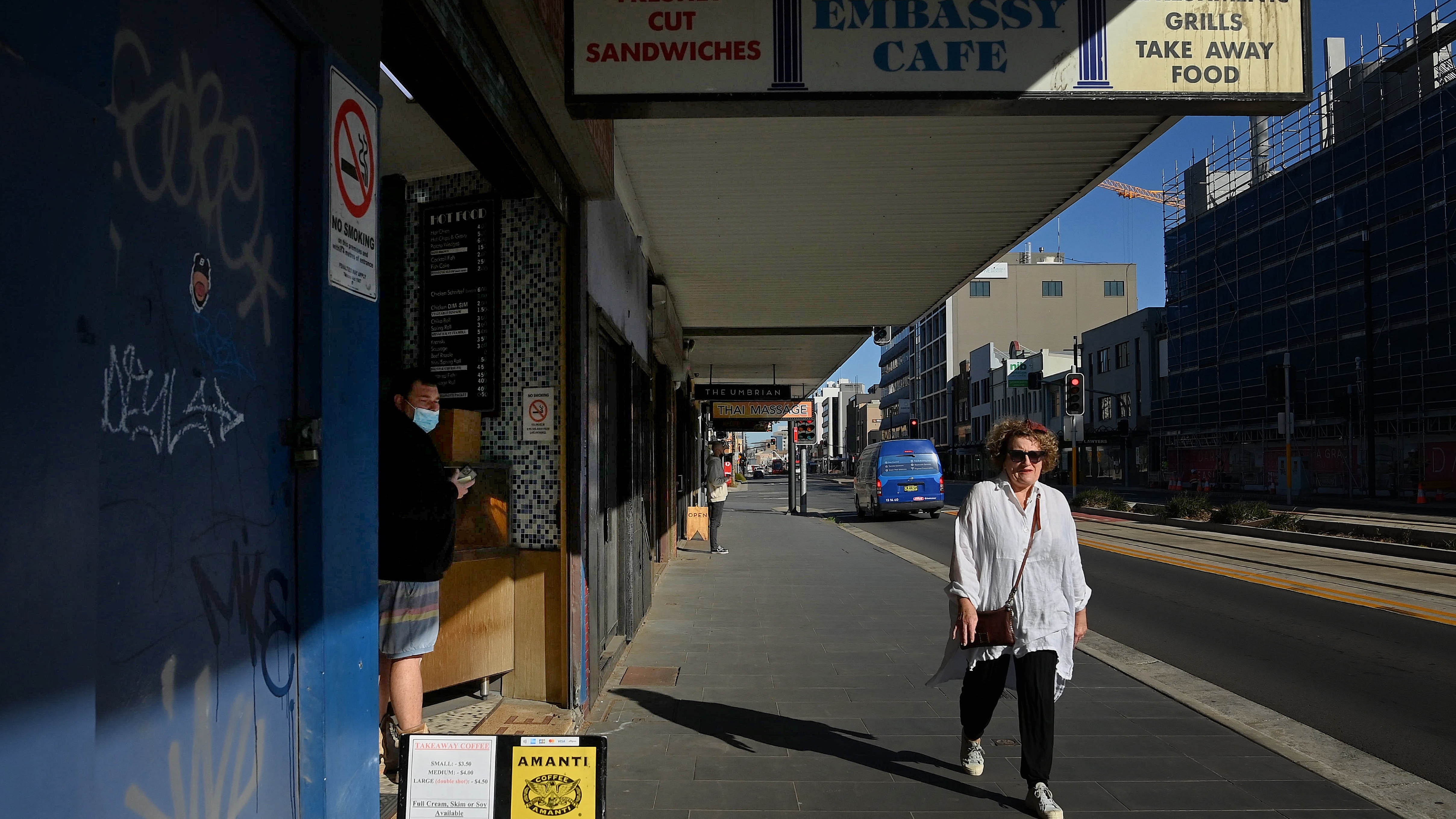 People walk along Hunter street in Newcastle during the seven day COVID-19 lockdown.
