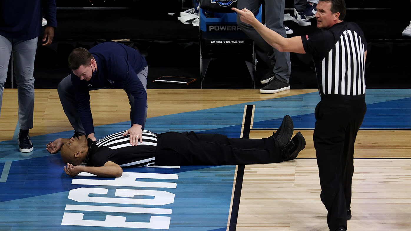 Referee Bert Smith lies on the court after collapsing during the first quarter of the NCAA Elite Eight match between USC and Gonzaga in Indiana.