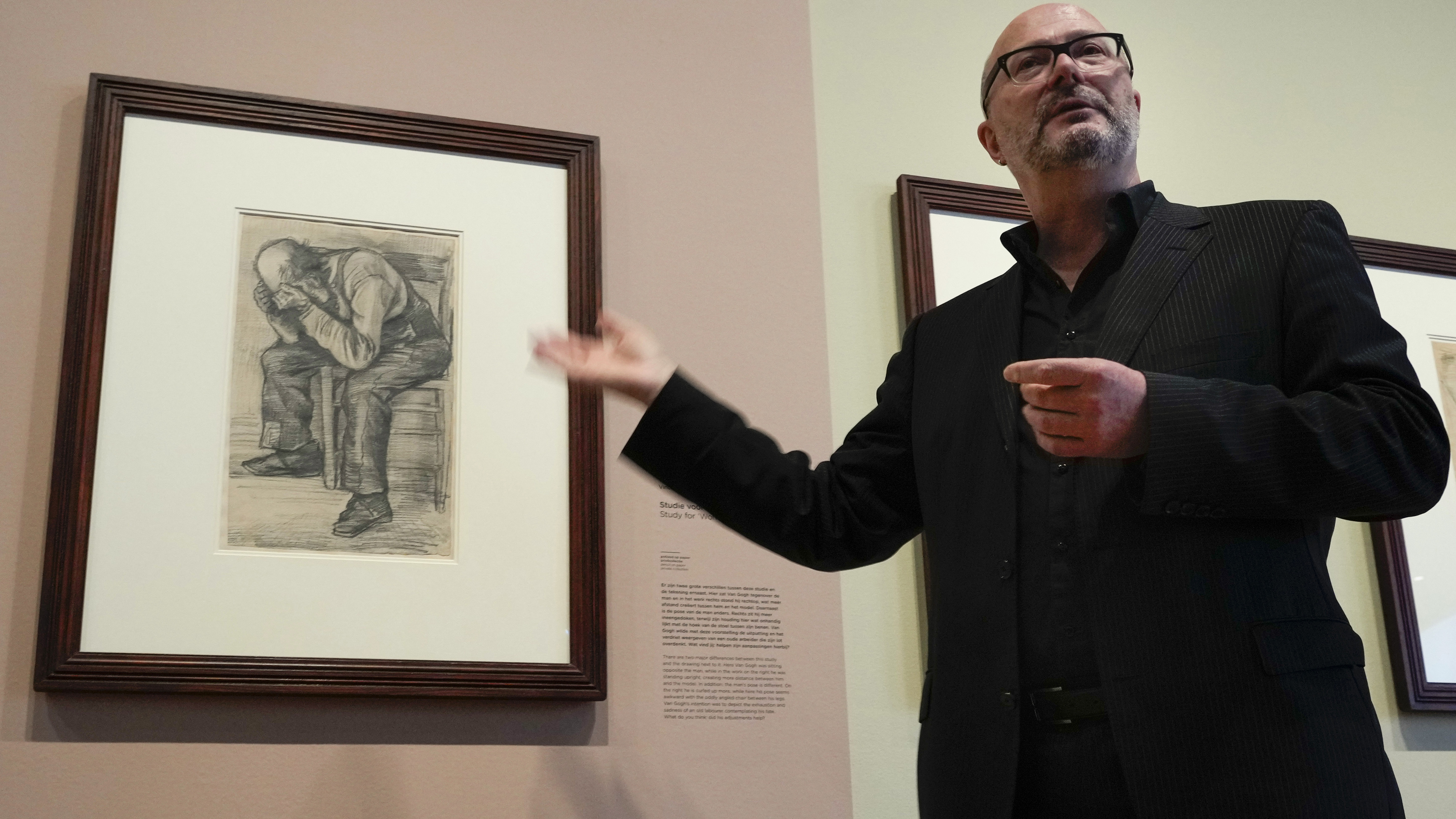 """Senior researcher Teio Meedendorp gestures during the presentation of Study for """"Worn Out"""", left, a drawing by Dutch master Vincent van Gogh, dated Nov. 1882, going on public display for the first time."""