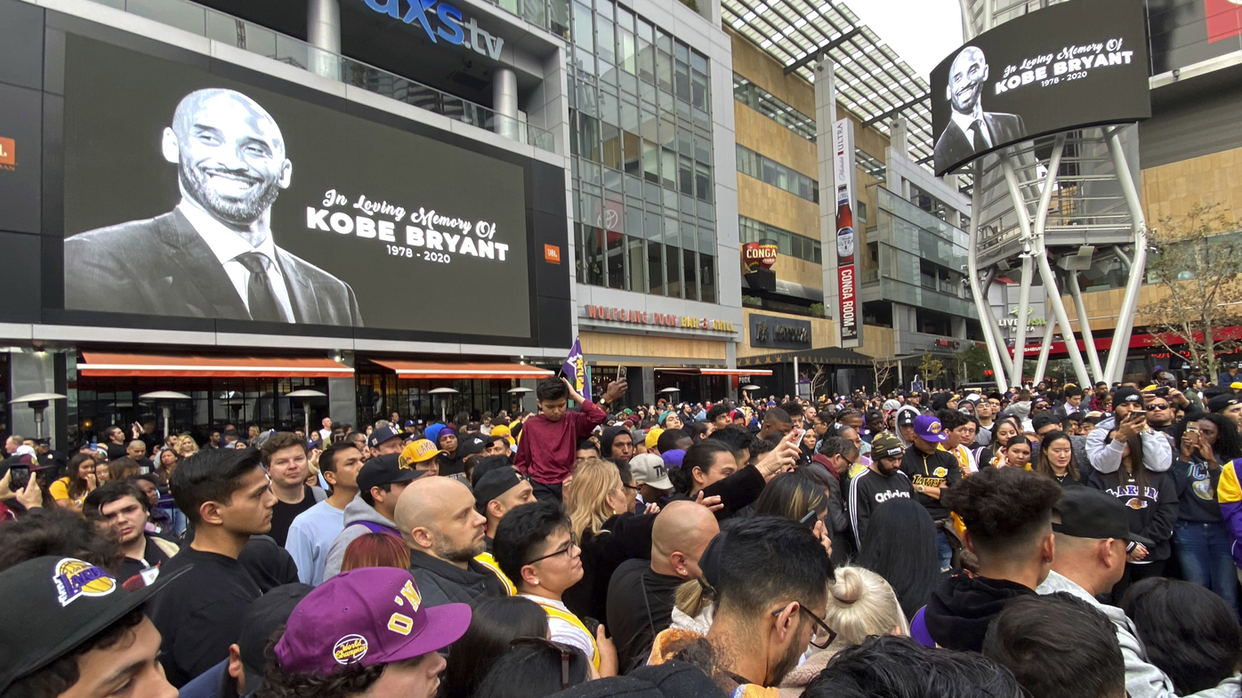 Thousands of fans mourn the loss of Kobe Bryant with makeshift memorials in front of the Staples Centre.
